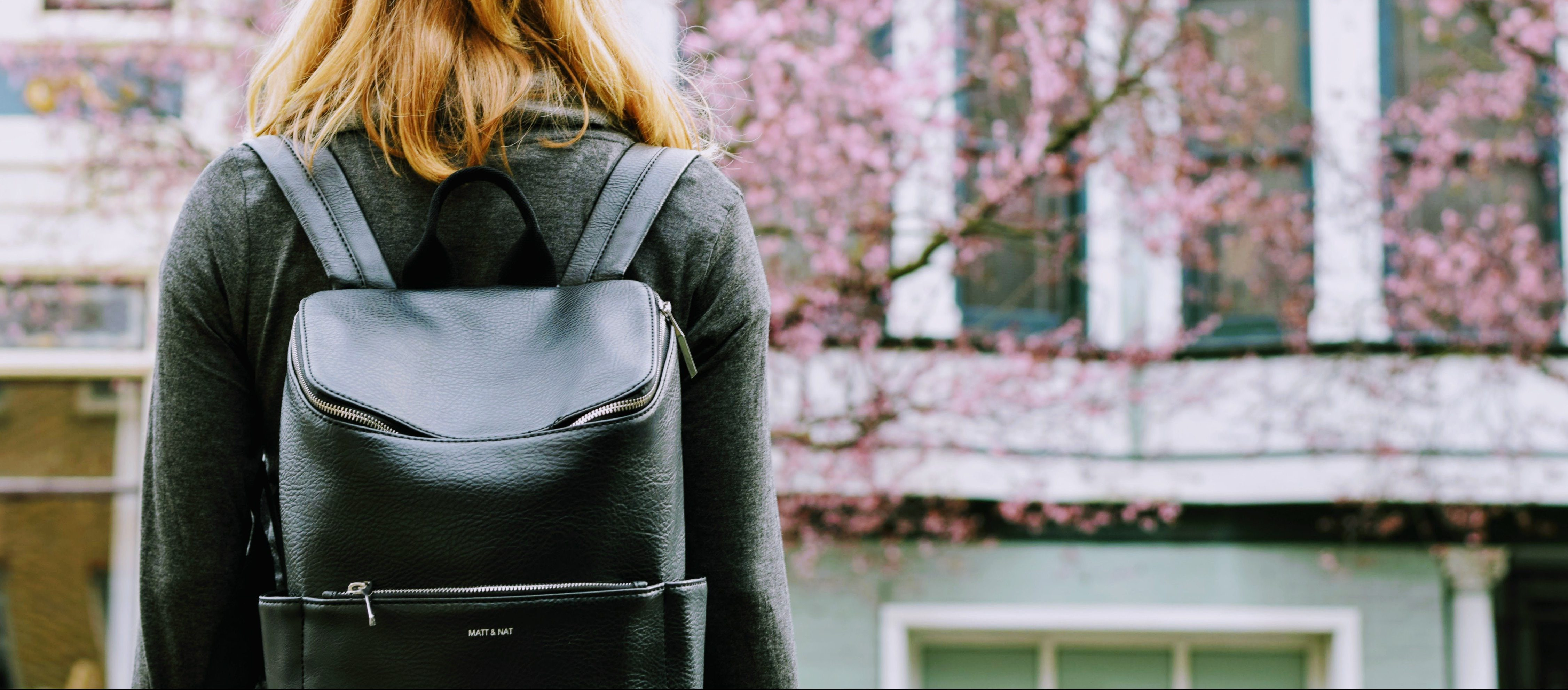 female student wearing backpack